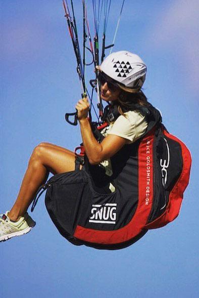 Iris flies paraglider near the capital of the island