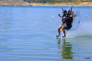 Vicente Palmero Flies just over the water pushed by his paramotor